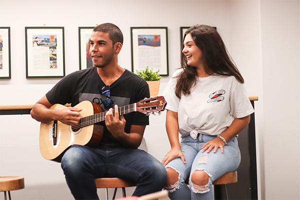 English Students in Brisbane play guitar and sing
