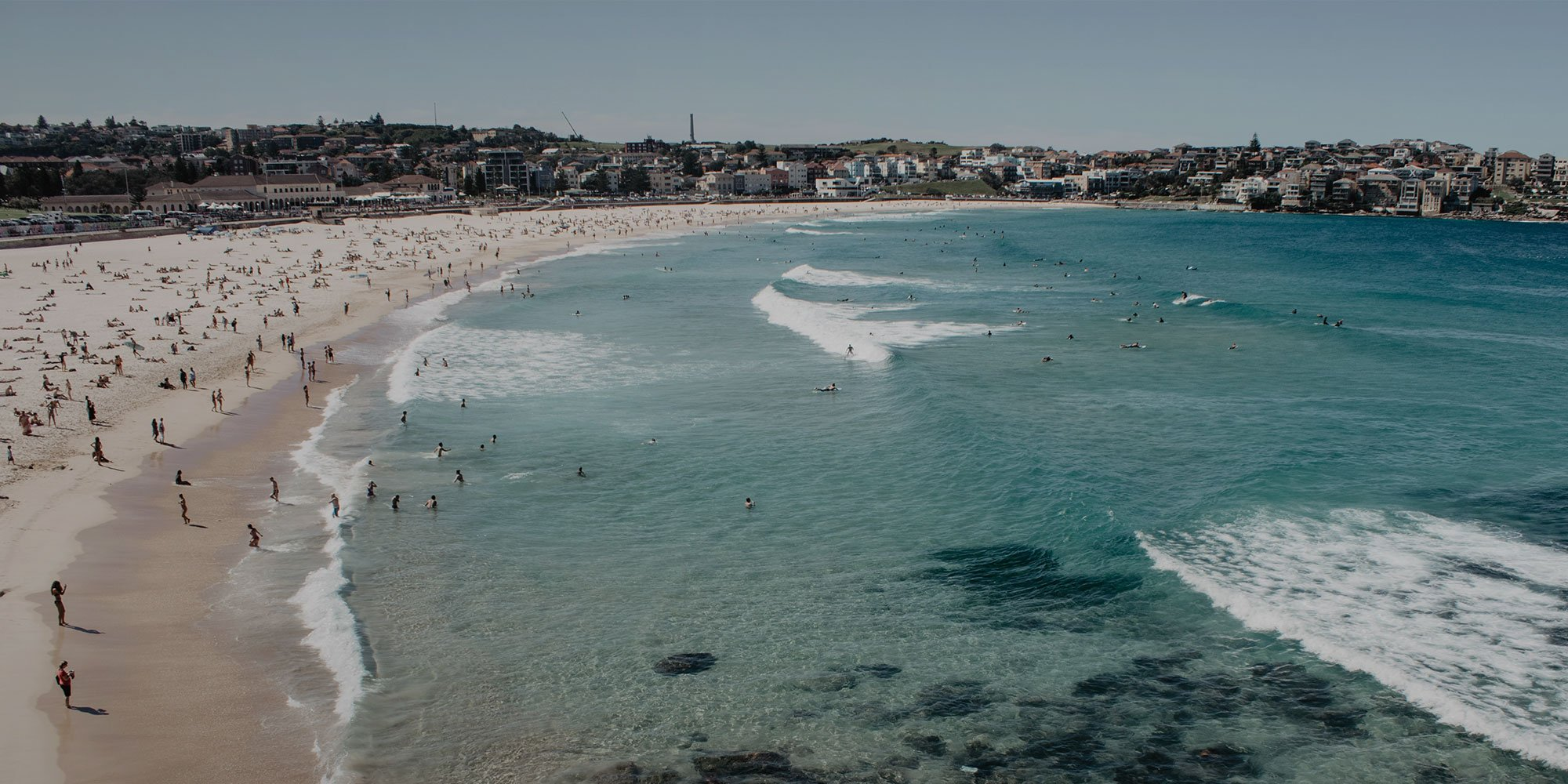 Crowds on Bondi beach in Sydney Australia, a great city to learn English