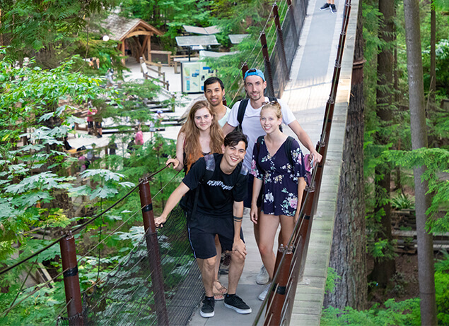 Group of international students from ILSC Vancouver explore Capilano Suspension Bridge outside of their English Study