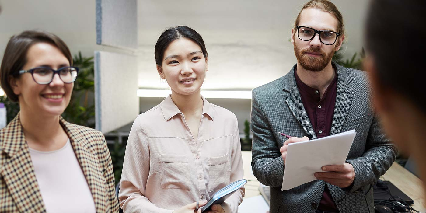 Three students dressed for work.  Work and study in Australia - international students typically have work rights included in their student visa