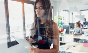 Digital marketer women in an office, study digital marketing at a career college in Canada with co-op programs