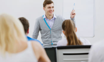 Man teaching class, study TESOL at Greystone College, a Career College in Vancouver, learn to be an English teacher.