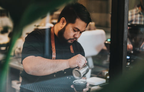 Barista pouring milk on a latte - Australia has lots of great jobs for international students who want to work and study